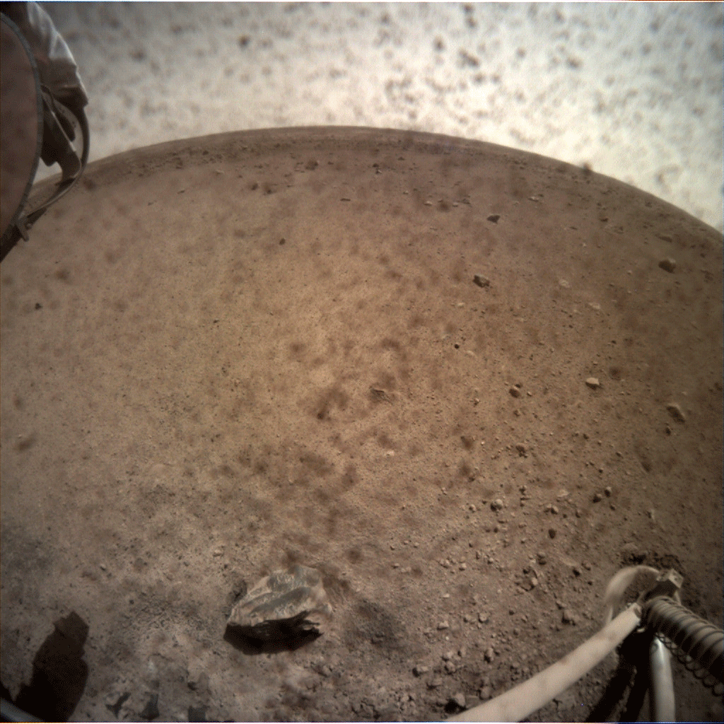 NASA's InSight spacecraft popped the lens cover off its Instrument Context Camera (ICC) on Nov. 30, 2018, and captured this view of Mars.