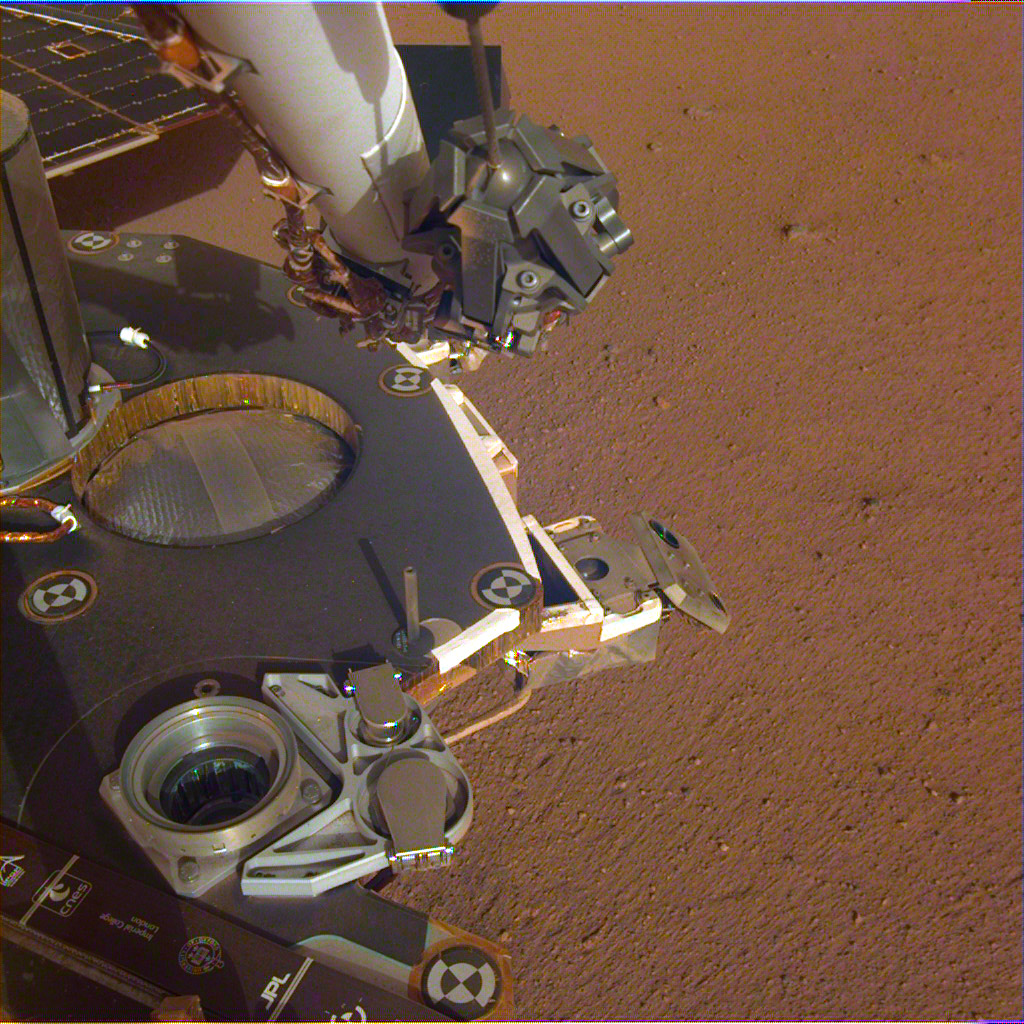 A partial view of the deck of NASA's InSight lander, where it stands on the Martian plains Elysium Planitia. The image was received on Dec. 4, 2018 (Sol 8).
