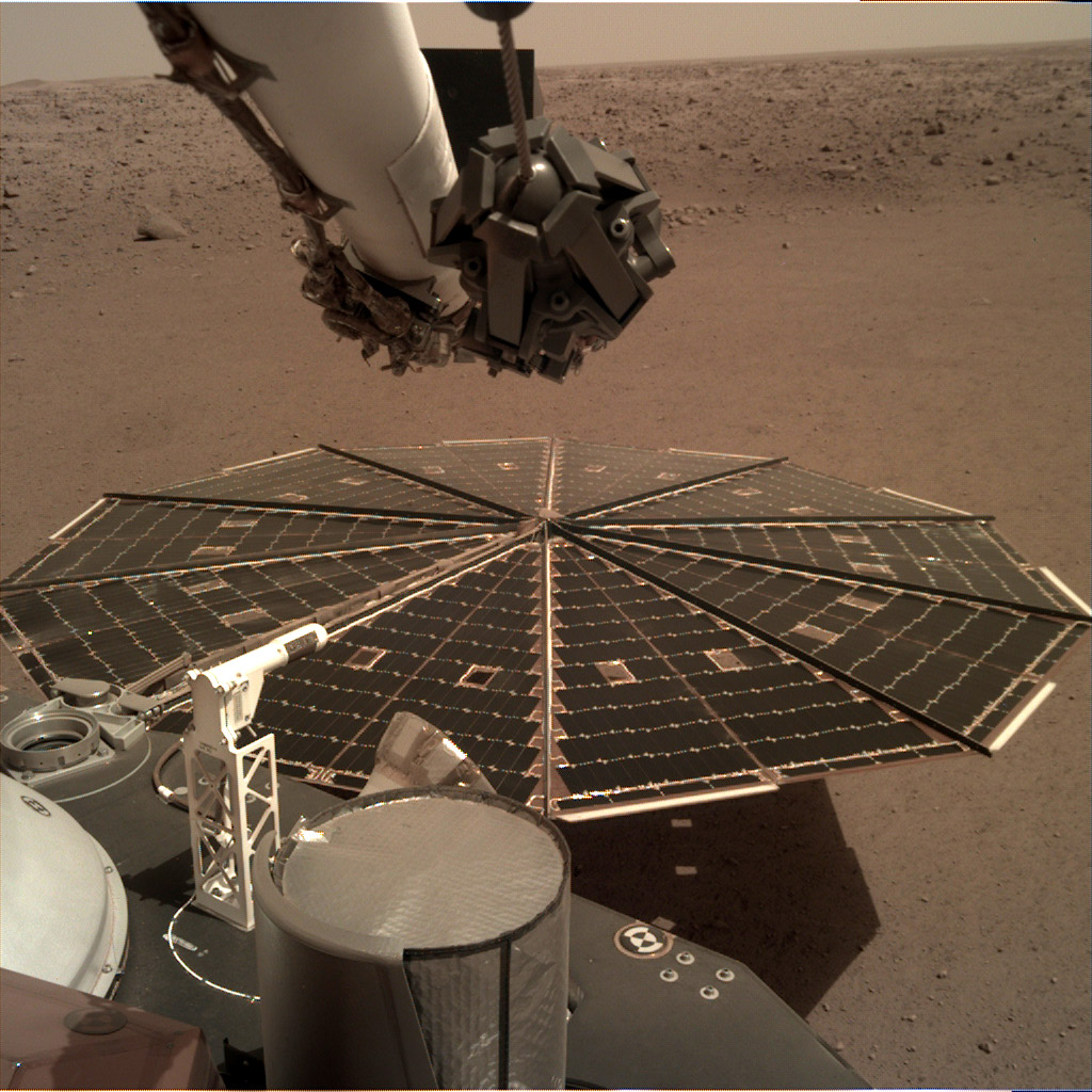 One of InSight's 7-foot (2.2 meter) wide solar panels was imaged by the lander's Instrument Deployment Camera, which is fixed to the elbow of its robotic arm.