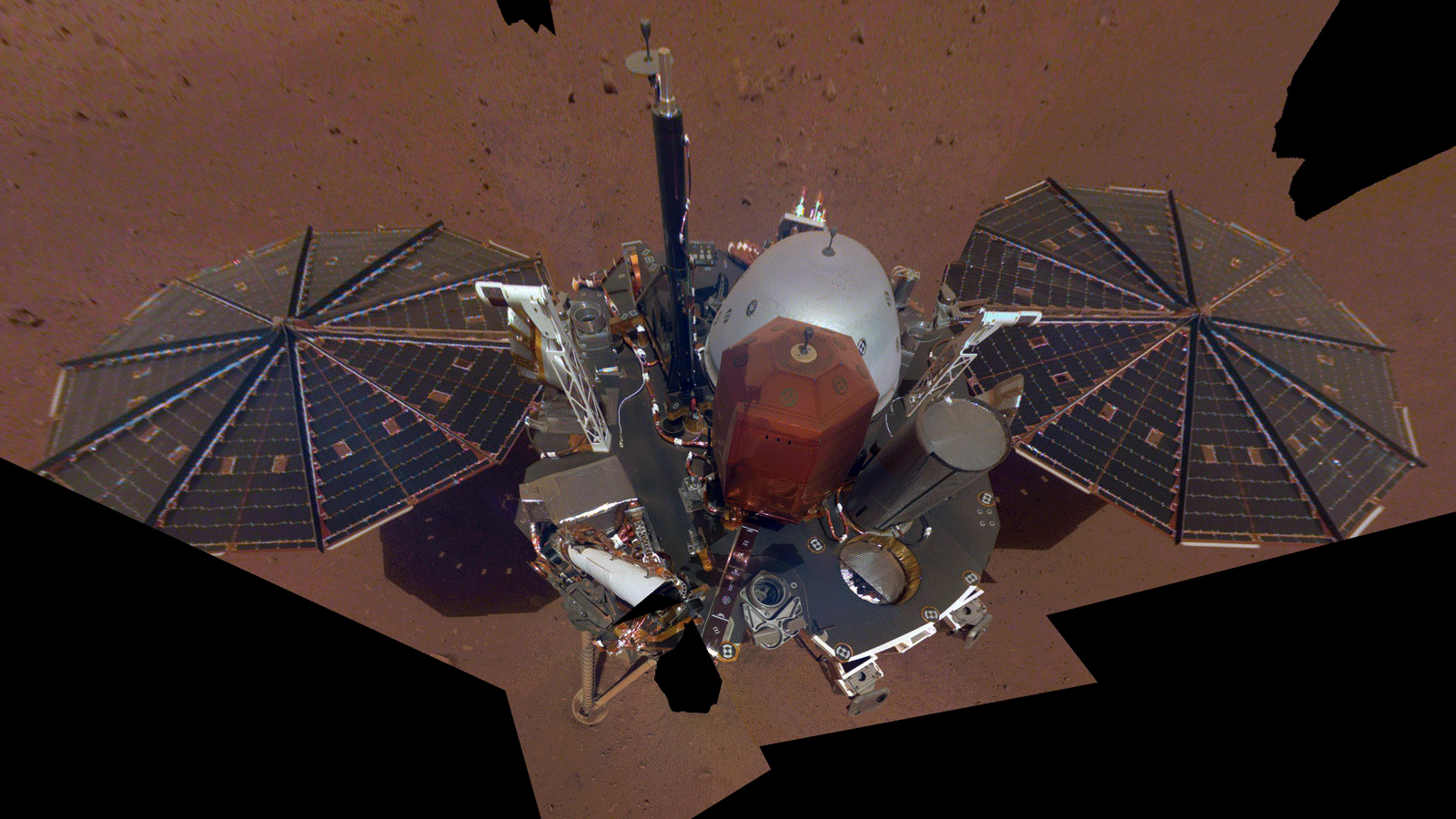 This is NASA InSight's first selfie on Mars. It displays the lander's solar panels and deck. On top of the deck are its science instruments, weather sensor booms and UHF antenna.