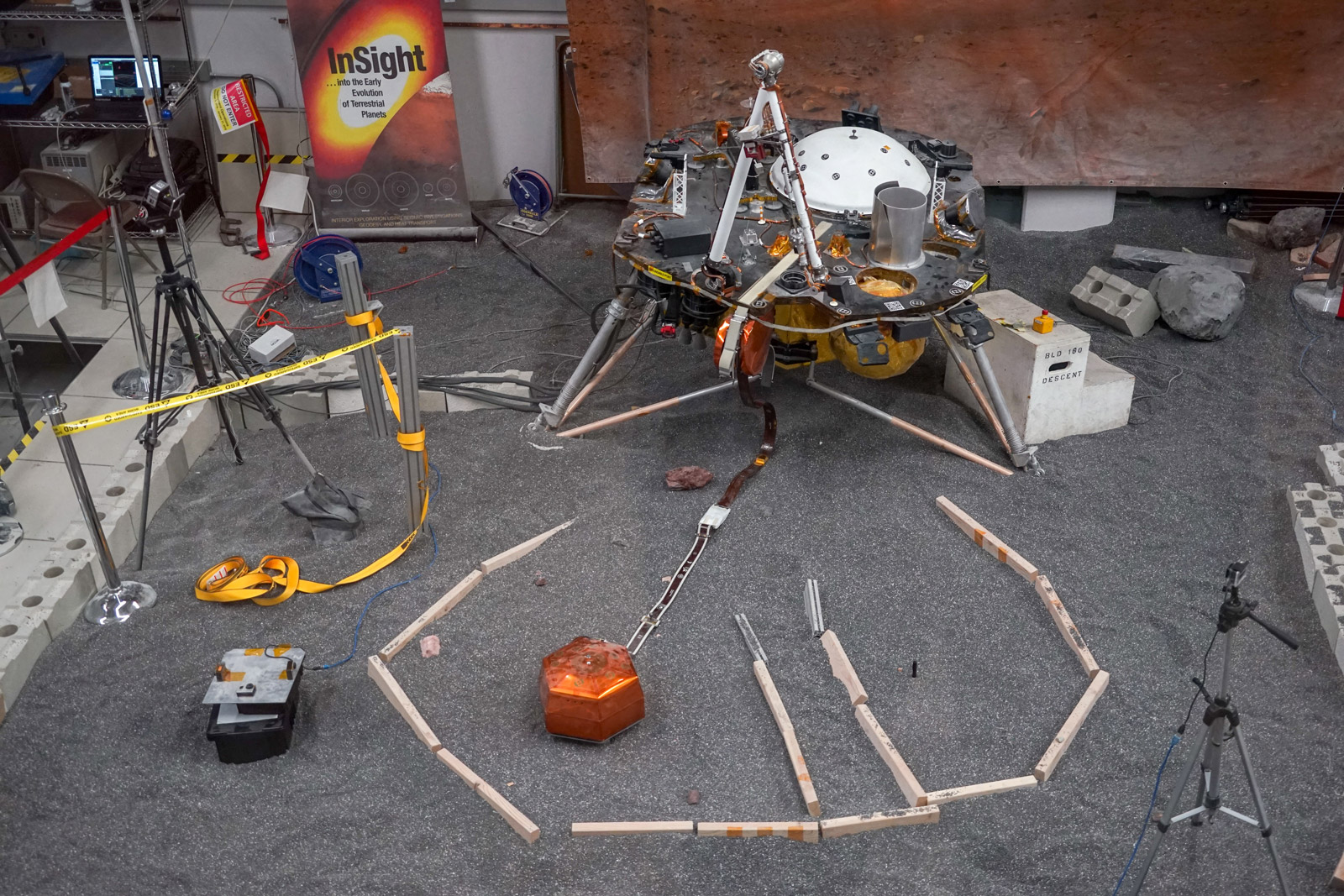 ForeSight, a fully functional, full-size model of NASA's InSight lander, sits in a lab space that has been sculpted to match terrain in front of the real lander on Mars. This work was done at NASA's Jet Propulsion Laboratory in Pasadena, California.