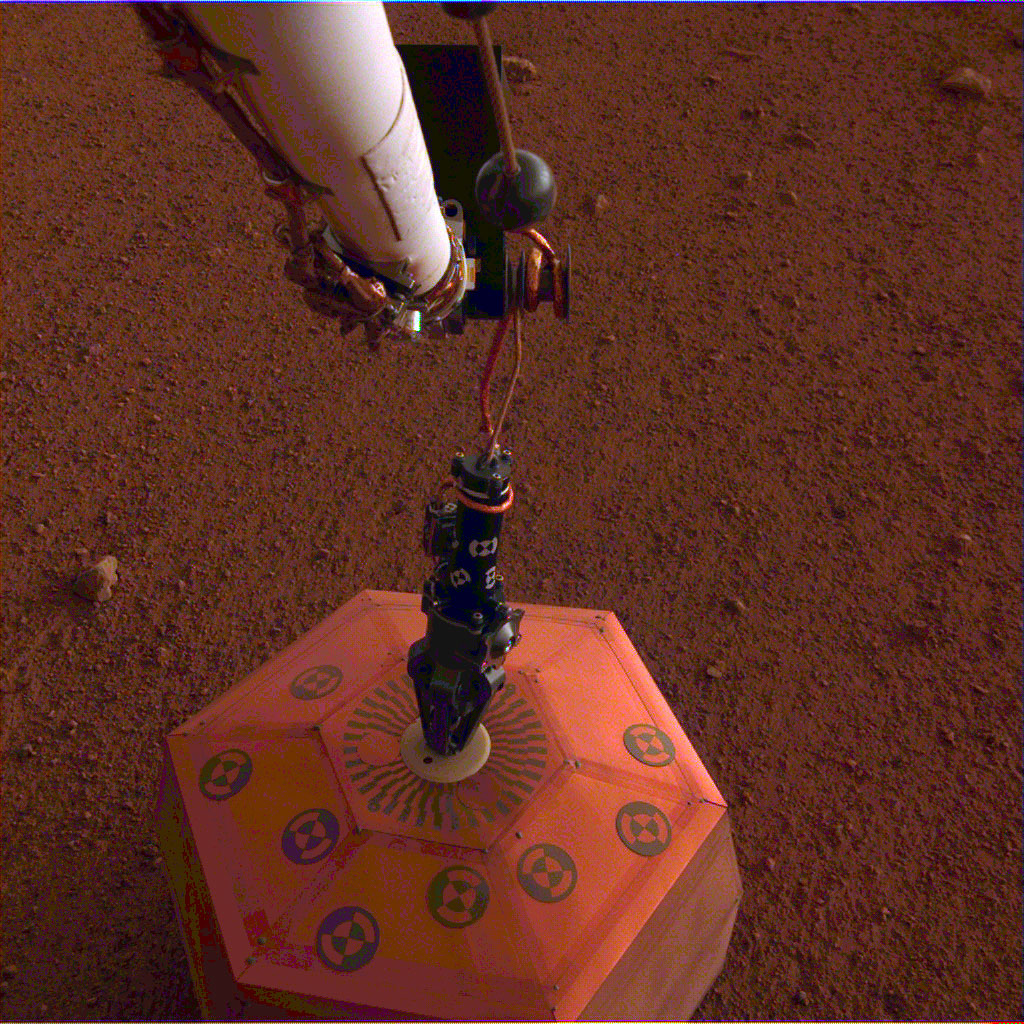 The seismometer is the copper-colored object in this image, which was taken around Martian dusk.