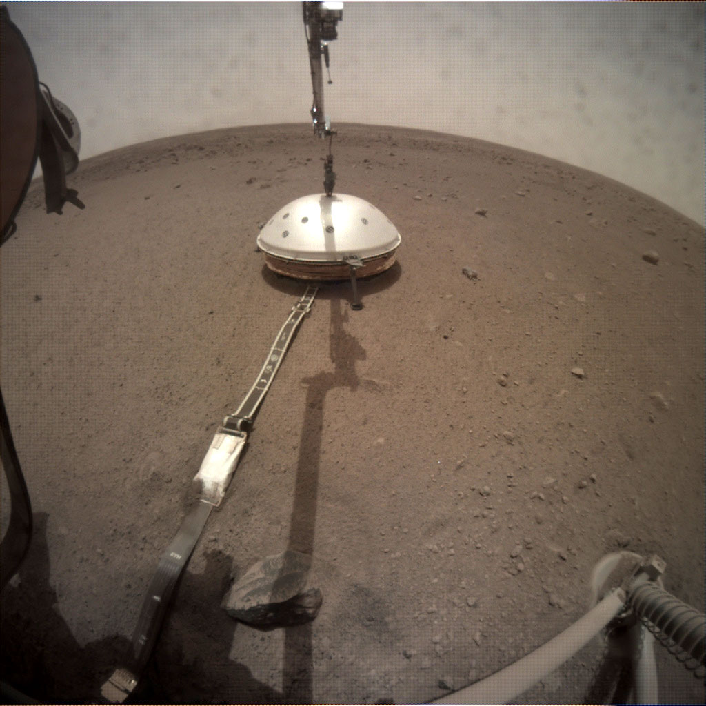 NASA's InSight lander deployed its Wind and Thermal Shield on Feb. 2 (Sol 66). The shield covers InSight's seismometer, which was set down onto the Martian surface on Dec. 19.