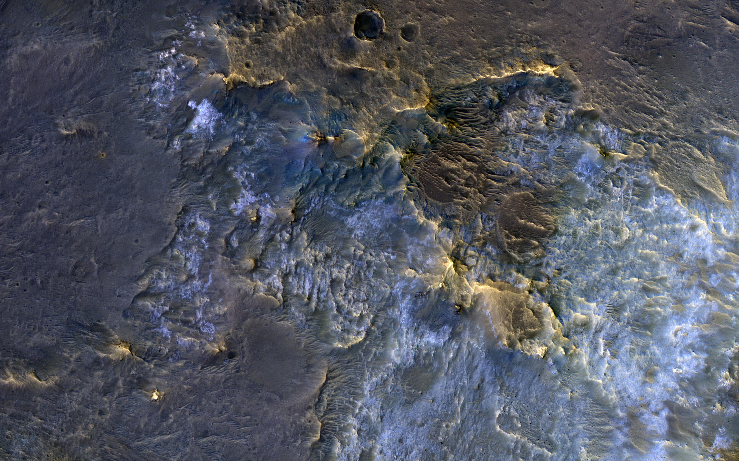 This image acquired on November 30, 2018 by NASAs Mars Reconnaissance Orbiter, shows a complex crater, where we see bedrock in several locations from different depths in the crust.