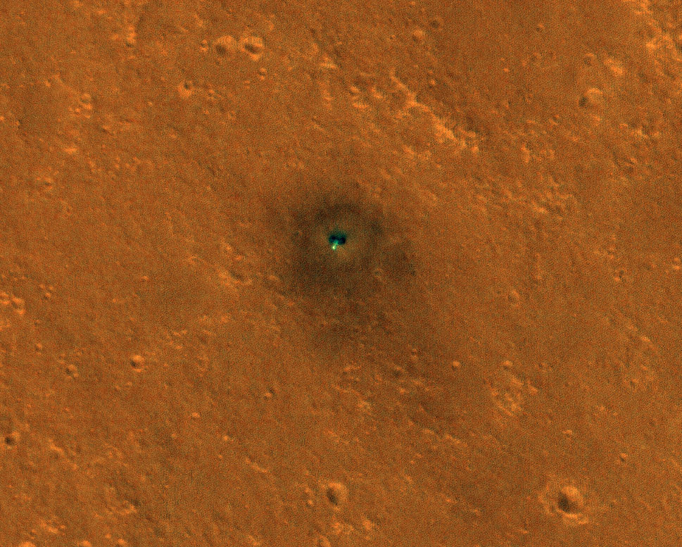 NASA's InSight spacecraft and its recently deployed Wind and Thermal Shield were imaged on Feb. 4 by the HiRISE camera aboard NASA's Mars Reconnaissance Orbiter.