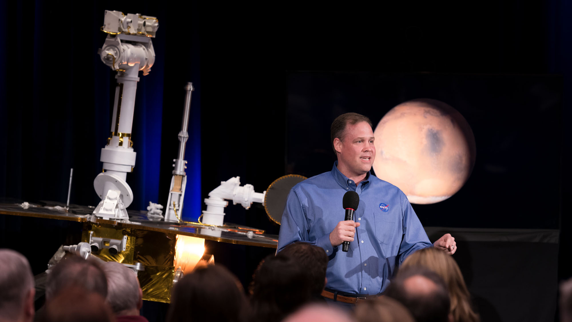 NASA Administrator Jim Bridenstine discusses the successful completion of the Opportunity Mars rover mission during a news briefing at the agency's Jet Propulsion Laboratory in Pasadena, California. Behind him to the left is a model of Opportunity and to the right behind him is an image of Mars.