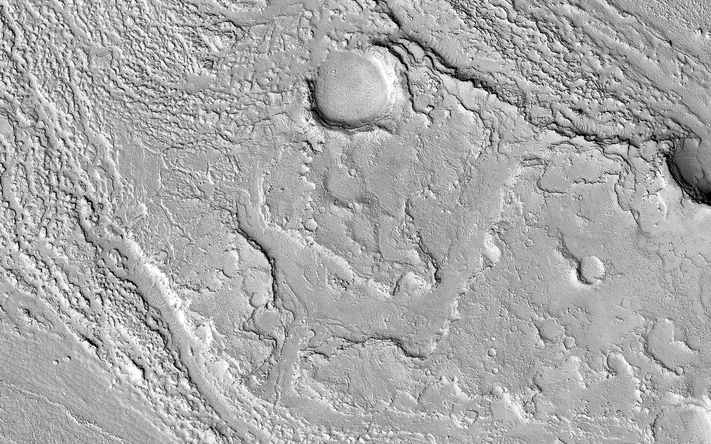 This image acquired on December 9, 2018 by NASAs Mars Reconnaissance Orbiter, shows Athabasca Valles with lava flows originating from Elysium Mons to the northwest.