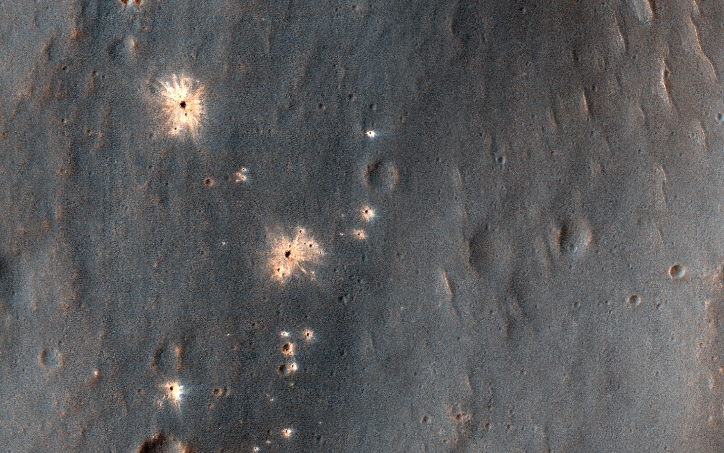 This image acquired on December 9, 2018 by NASAs Mars Reconnaissance Orbiter, shows a recent impact in Noachis Terra in the southern mid-latitudes of Mars.
