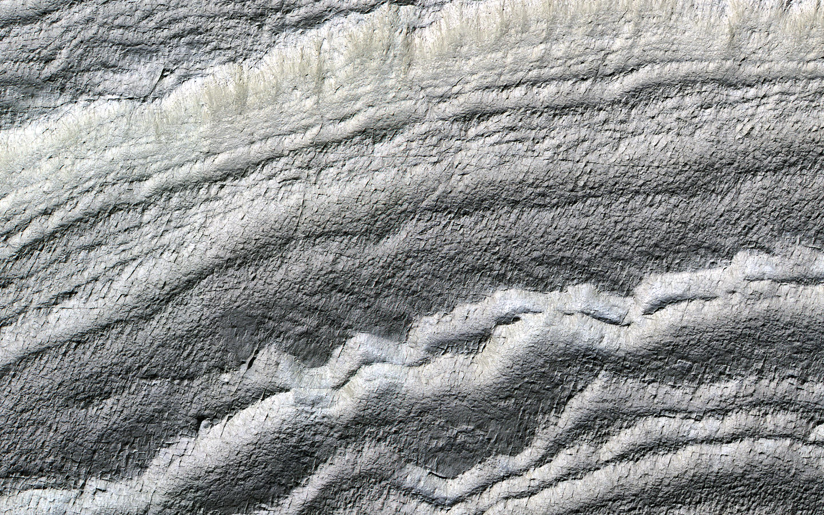 This image acquired on January 21, 2019 by NASAs Mars Reconnaissance Orbiter, shows the south polar layered deposits are well illuminated to accentuate the topography.