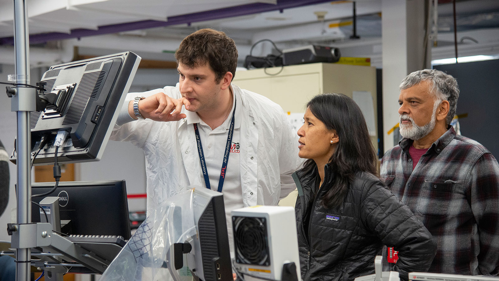 Teddy Tzanetos, MiMi Aung and Bob Balaram of NASA's Mars Helicopter project observe a flight test.