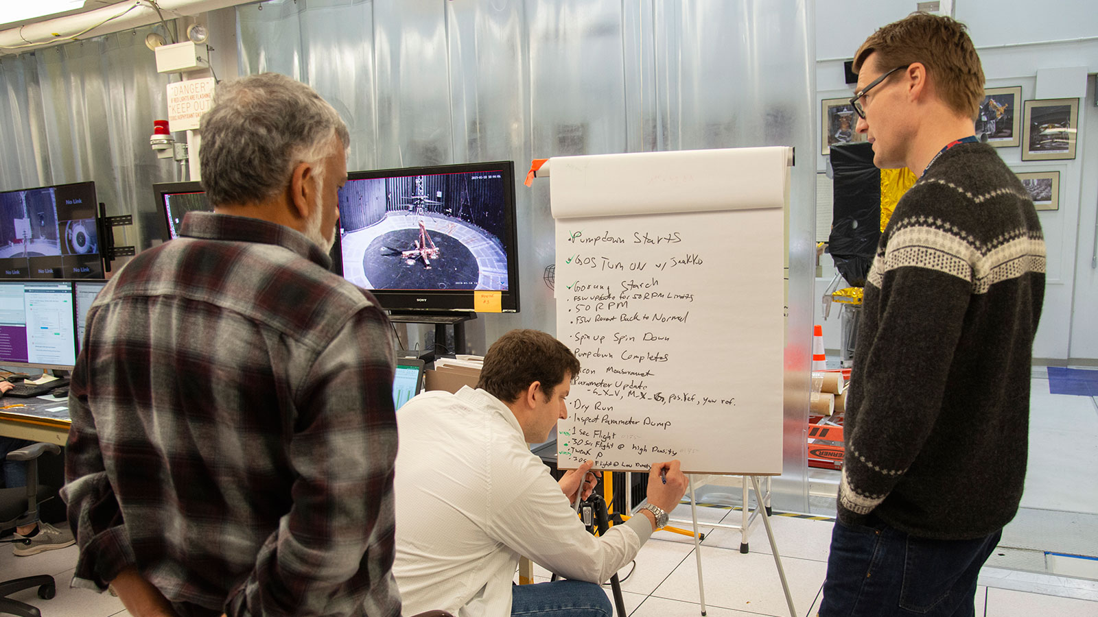 Bob Balaram, Teddy Tzanetos and Havard Grip from the NASA Mars Helicopter project discuss test results.