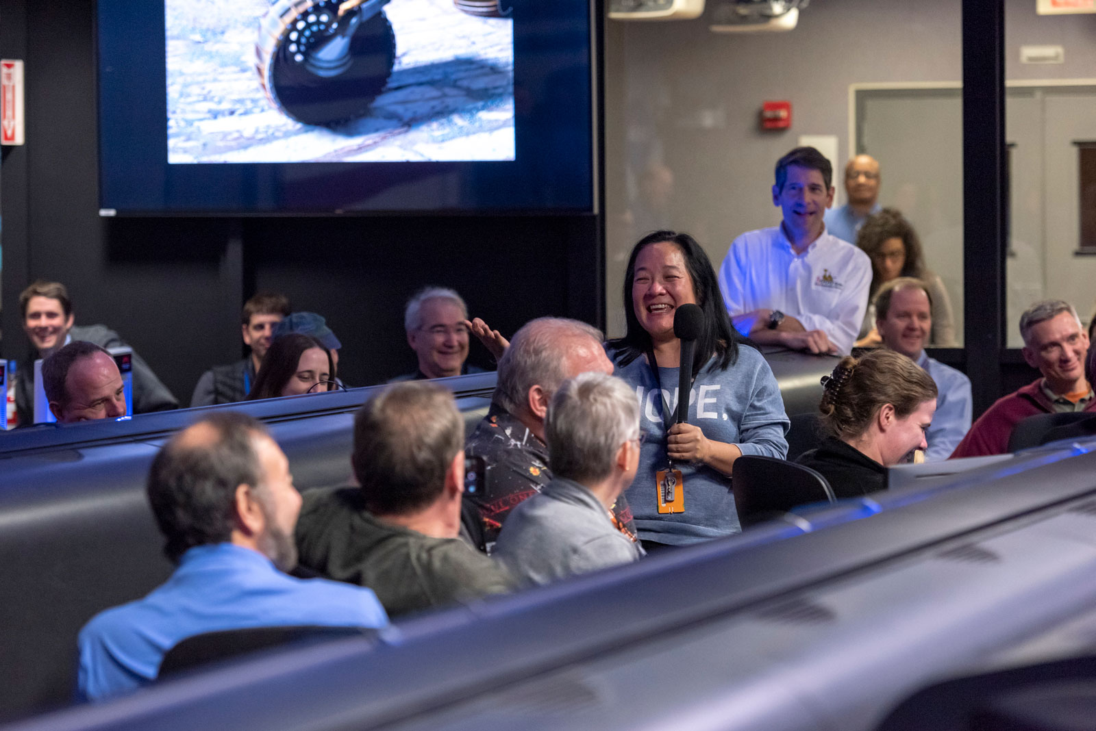 Cindy Oda stood up to share her experience working with NASA's Opportunity rover during a team meeting in Mission Control at NASA's Jet Propulsion Laboratory in Pasadena, California.