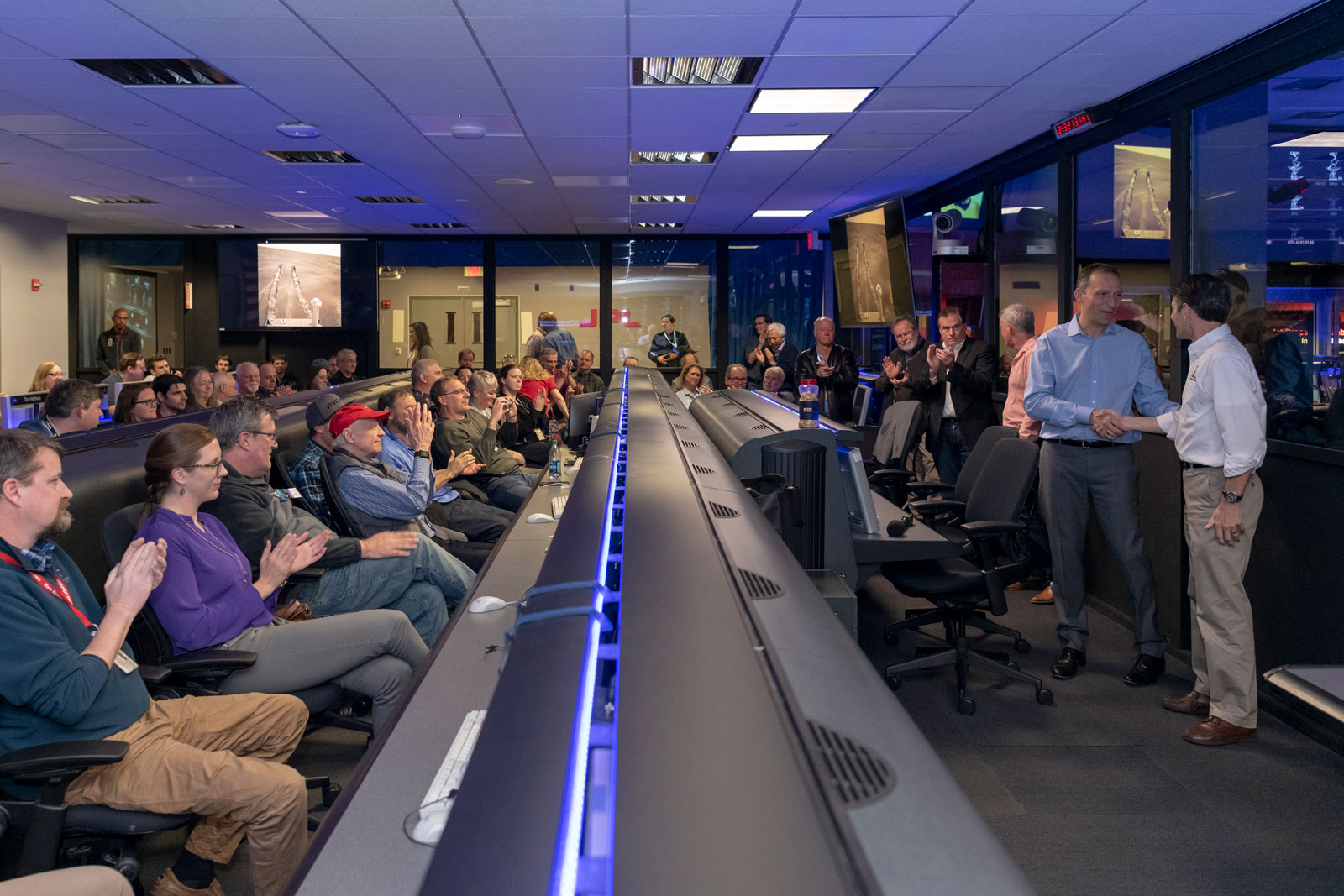 Scientists and engineers who worked on NASA's Opportunity rover give mission leadership a round of applause in Mission Control at NASA's Jet Propulsion Laboratory in Pasadena, California.