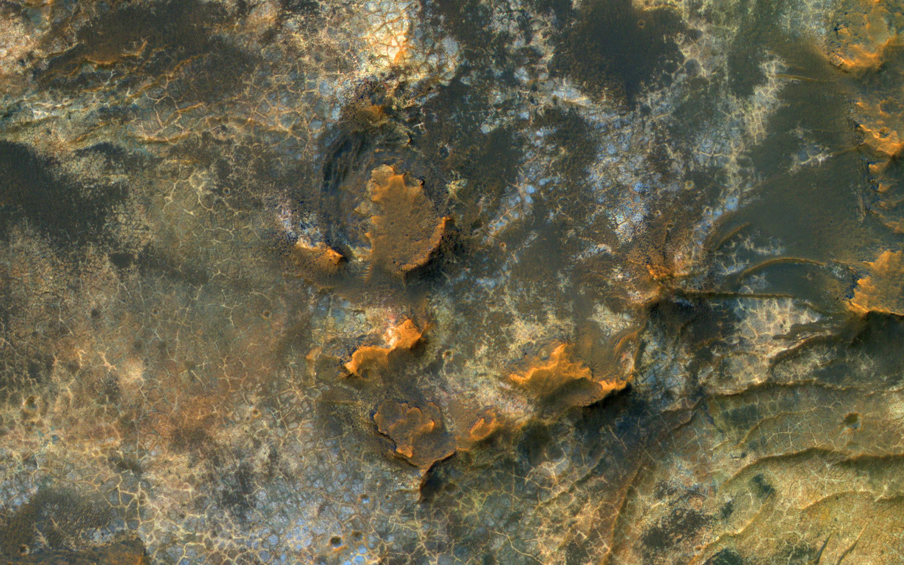 This image acquired on January 27, 2019 by NASAs Mars Reconnaissance Orbiter, reveals small-scale shapes that often correlate with mineral units and provides information about stratigraphy.