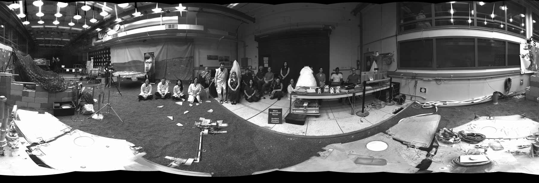 "This 360-degree panorama was taken by ""Dusty,"" a fully-working replica of NASA's Opportunity rover at the agency's Jet Propulsion Laboratory. The panorama was taken as part of a software test. Members of the Opportunity team gathered to sit in during the panorama."