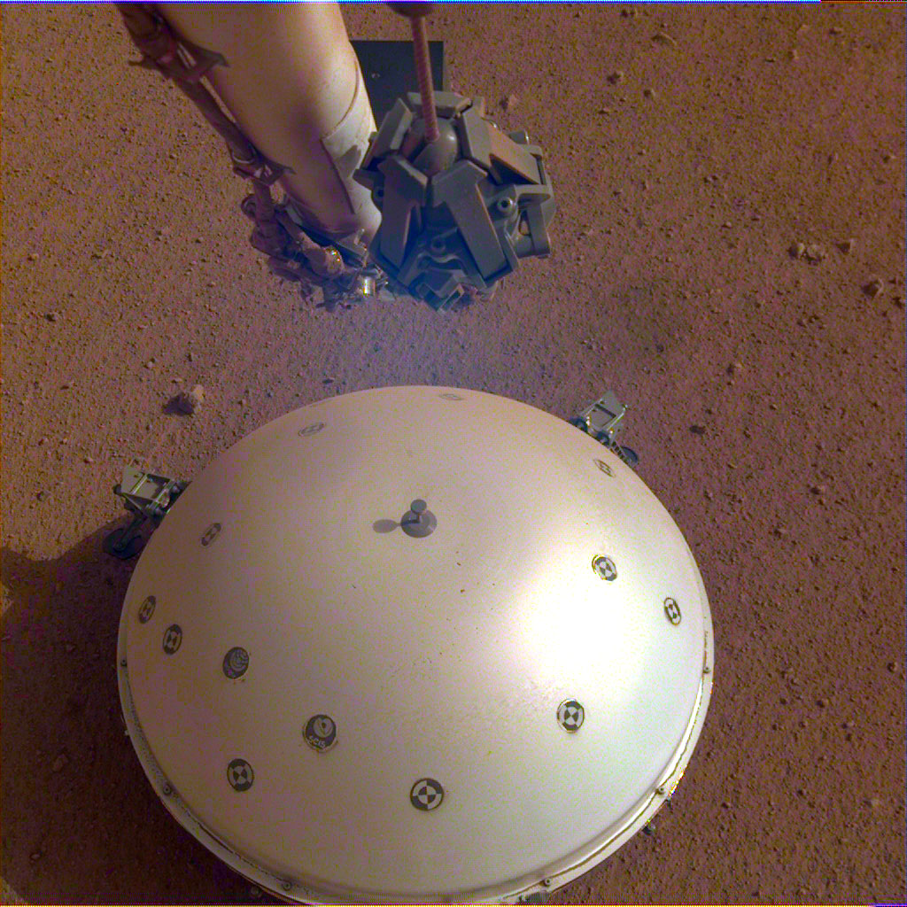 This image shows InSight's domed Wind and Thermal Shield, which covers its seismometer. The image was taken on the 110th Martian day, or sol, of the mission. The seismometer is called Seismic Experiment for Interior Structure, or SEIS.