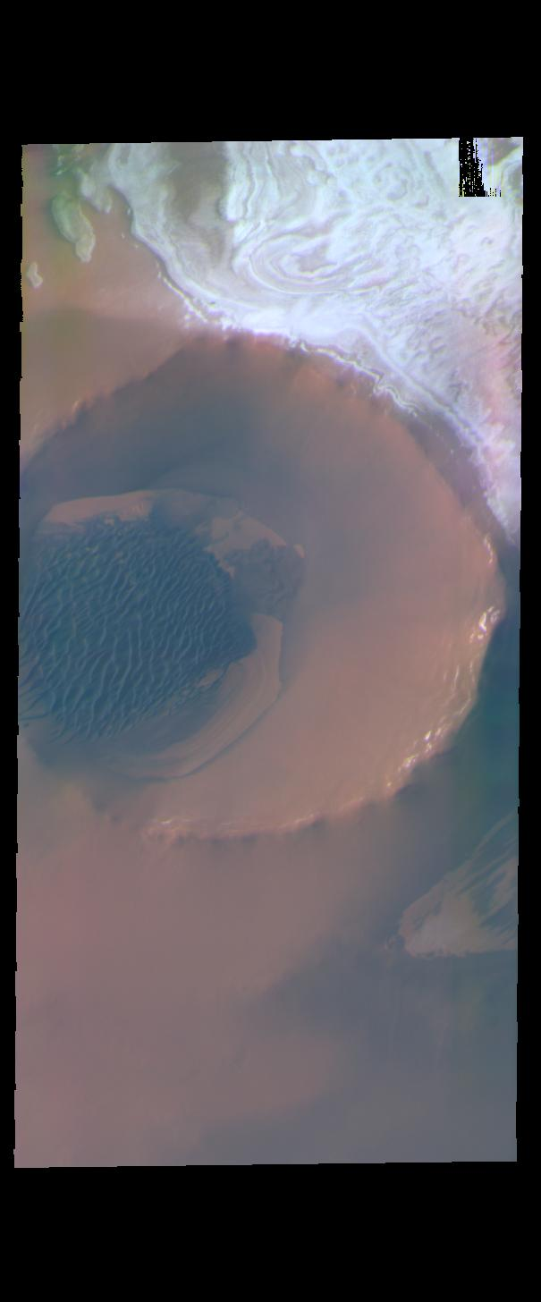 This image from NASAs Mars Odyssey shows Inuvik Crater, located near the north polar cap.