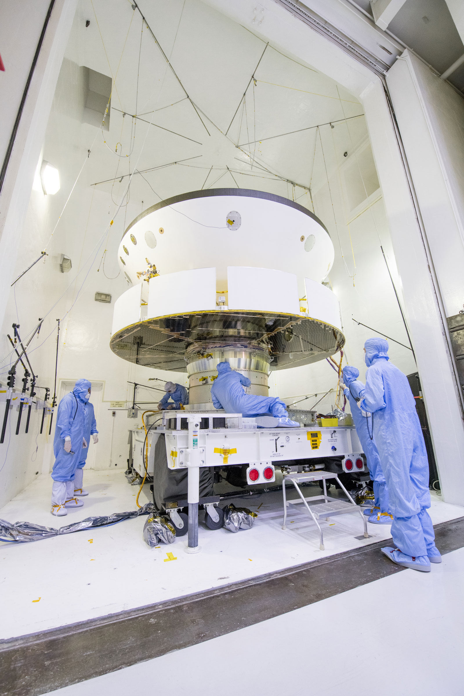 NASA's Mars 2020 spacecraft undergoes examination prior to an acoustic test in the Environmental Test Facility at NASA's Jet Propulsion Laboratory in Pasadena, California.