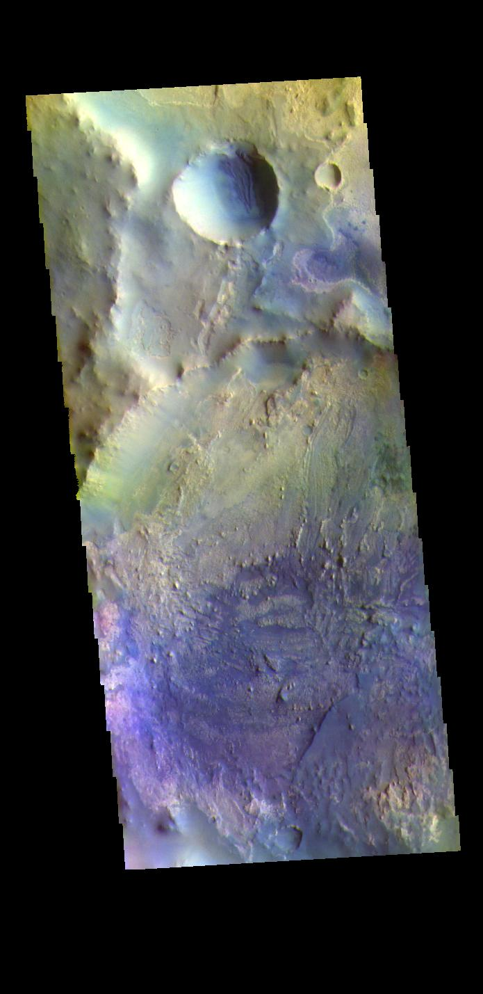 This image from NASAs Mars Odyssey shows part of an unnamed crater in Arabia Terra.