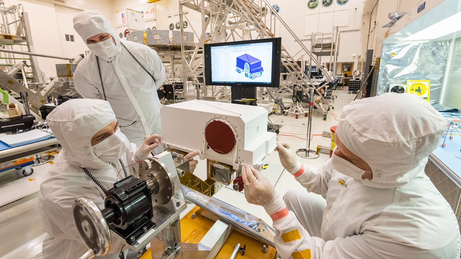 Technicians install a Mastcam-Z high-definition camera in the remote sensing mast that will later go on NASA's Mars 2020 rover.