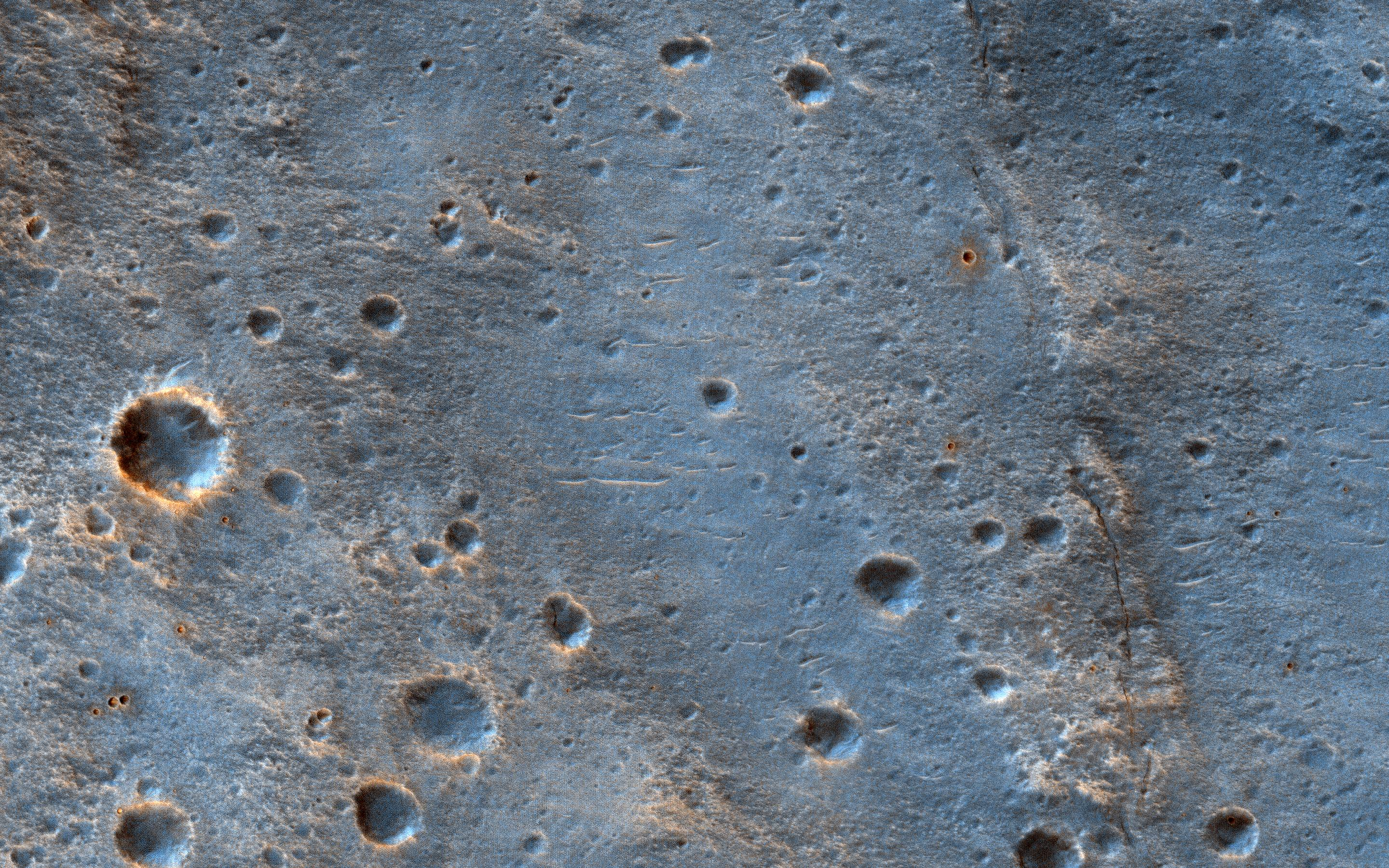 This image, acquired on May 16, 2019 by NASAs Mars Reconnaissance Orbiter, shows a cratered area to the southeast of the ExoMars 2020 Rosalind Franklin rover landing site at Oxia Palus.