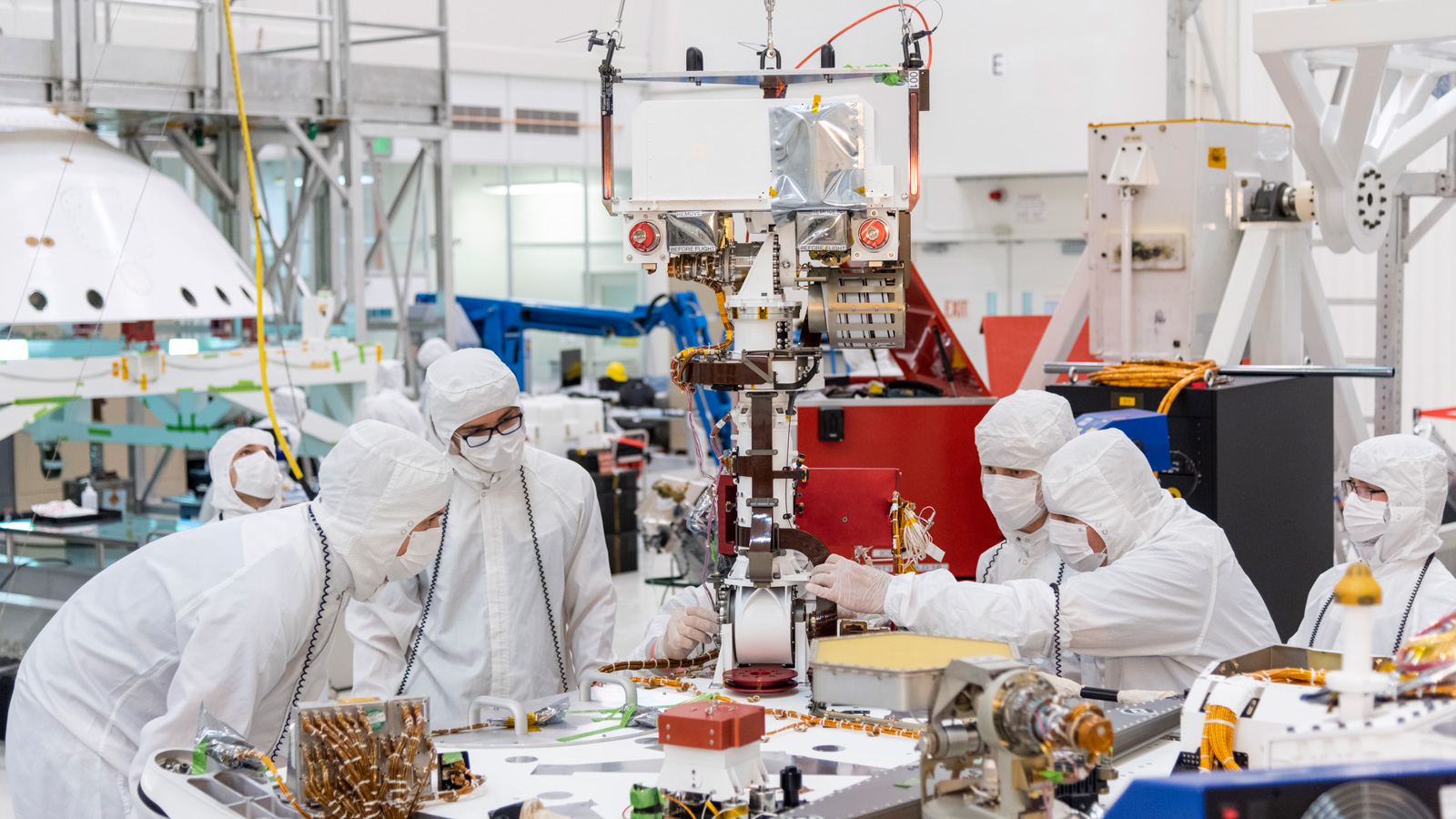 Engineers and technicians at NASA's Jet Propulsion Laboratory in Pasadena, California, install the remote sensing mast on the Mars 2020 rover.