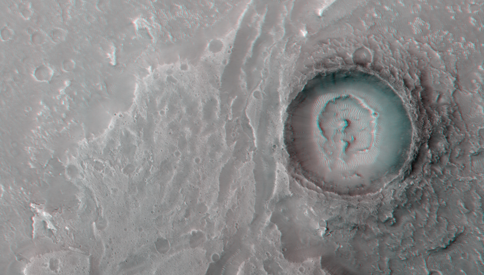 This image show a fan-shaped deposit where a channel enters a crater.