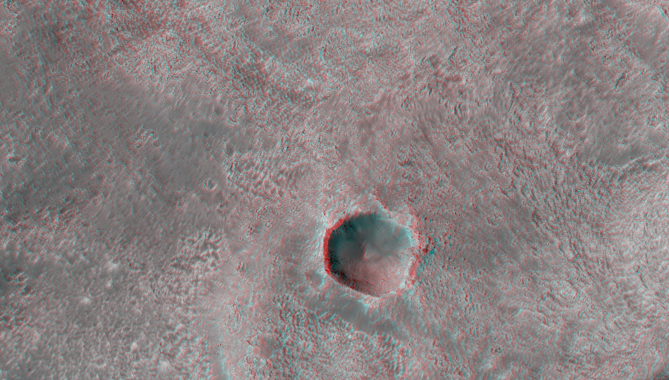 This DLE [double layer ejecta] crater formed at the edge of an older/pre-existing crater