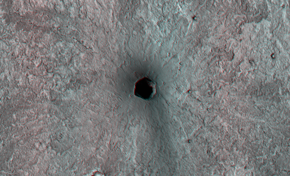 This is a small volcano superposed on the flanks of a larger one of the Cerberus Tholi.