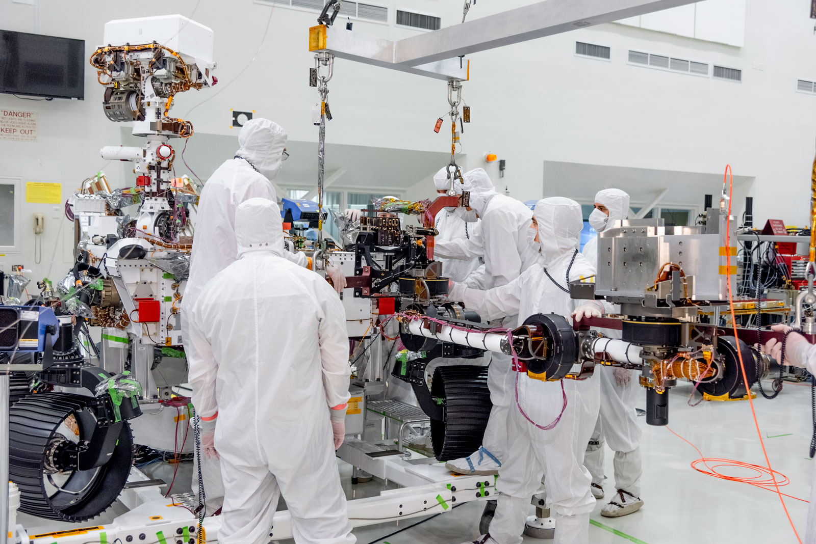 On June 21, 2019, engineers at NASA's Jet Propulsion Laboratory install the main robotic arm on the Mars 2020 rover.