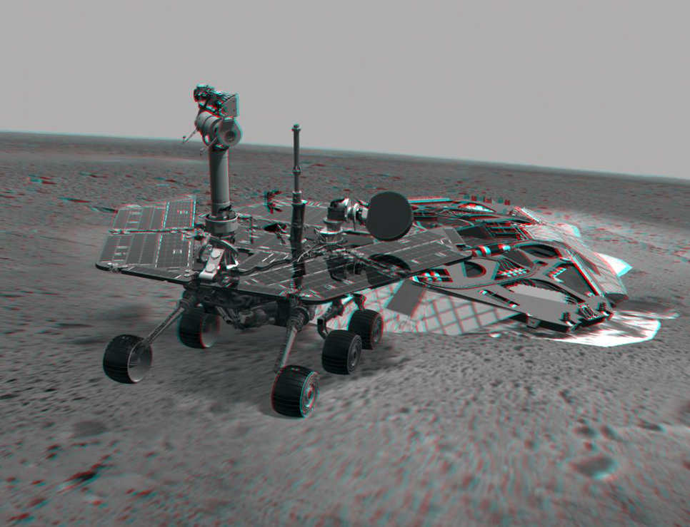 This 3-D image combines computer-generated models of the Mars Exploration Rover Spirit and its lander with real surface data from the rover's panoramic camera