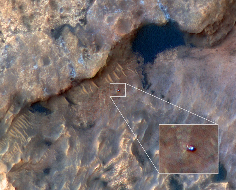 NASA's Curiosity Mars rover can be seen in this image taken from space by the HiRISE camera aboard the Mars Reconnaissance Orbiter.