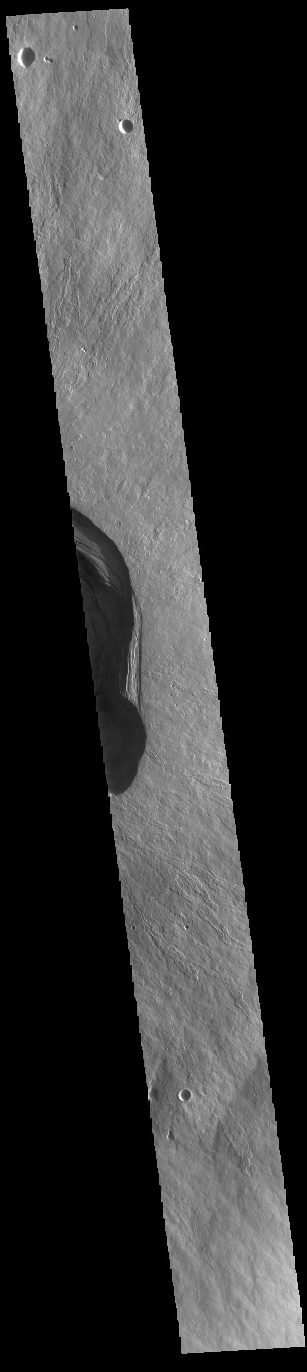 This image from NASAs Mars Odyssey shows the summit of Ascraeus Mons, one of the three large Tharsis region volcanoes.