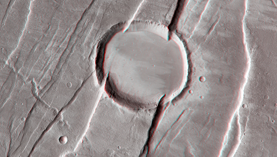 Tantalus Fossae are a set of faults on the eastern flank of Alba Mons, one of the great Tharsis Montes volcanoes.
