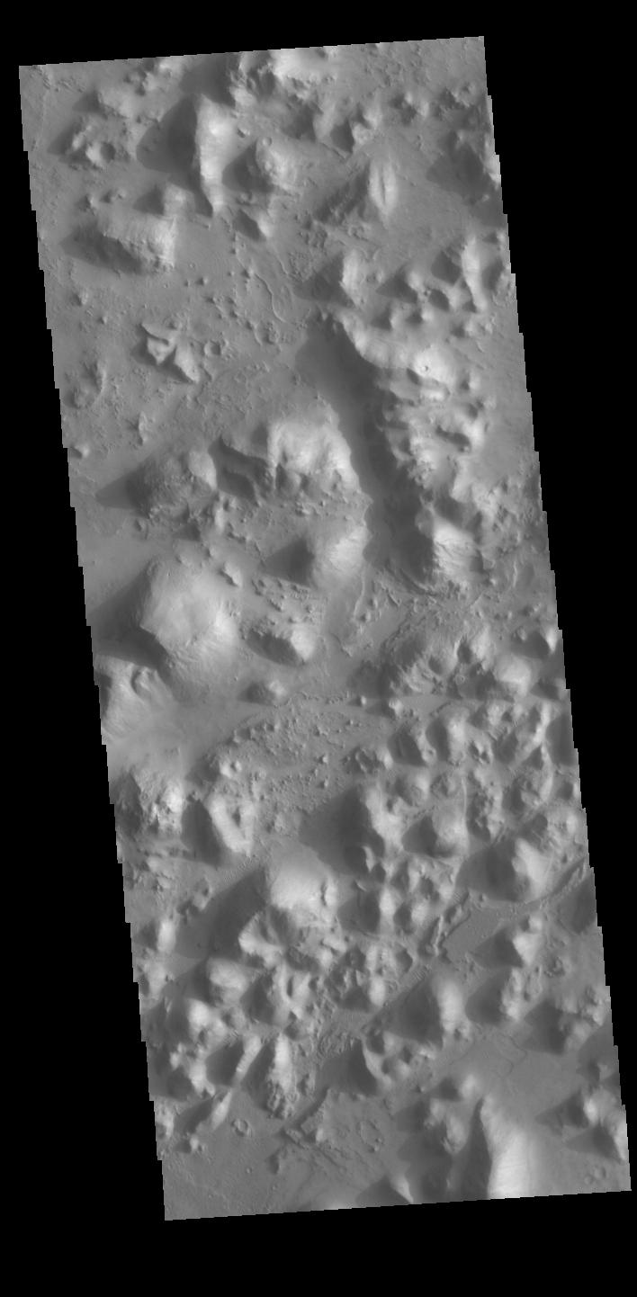 This image from NASAs Mars Odyssey shows part of Arena Colles. The term colles means hills.