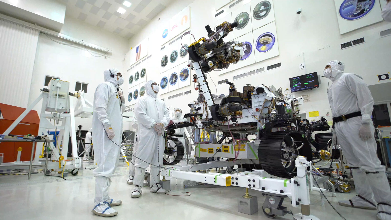 Photo taken in the clean room with the rover's 7-foot-long arm and its 88-pound sensor-laden turret as it moves from a deployed to a stowed configuration.