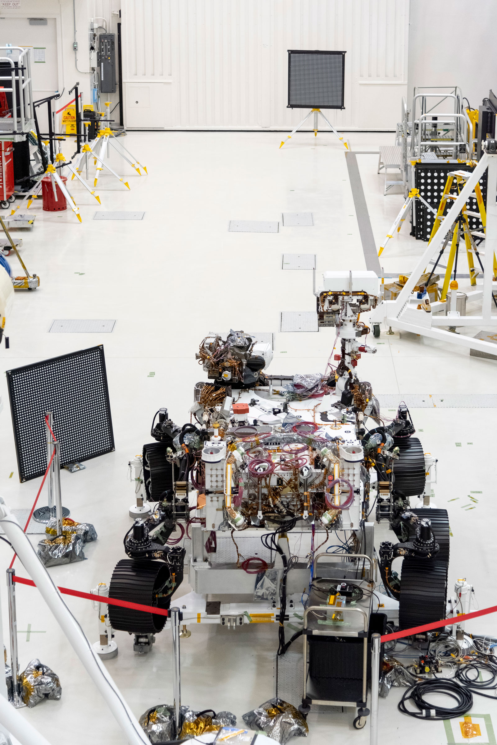 "The Mars 2020 rover undergoes an ""eye"" exam after several cameras were installed. The rover carries everything from wide-angle landscape cameras to narrow-angle high-resolution zoom lens cameras. The image was taken on July 23, 2019, in the Spacecraft Assembly Facility's High Bay 1 at the Jet Propulsion Laboratory in Pasadena, California."