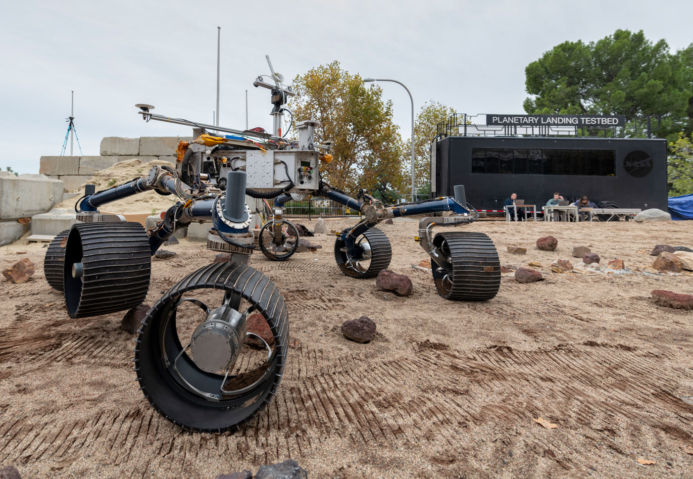 An engineering model of NASA's Mars 2020 rover makes tracks during a driving test in the Mars Yard, an area that simulates Mars-like conditions at NASA's Jet Propulsion Laboratory in Pasadena, California.