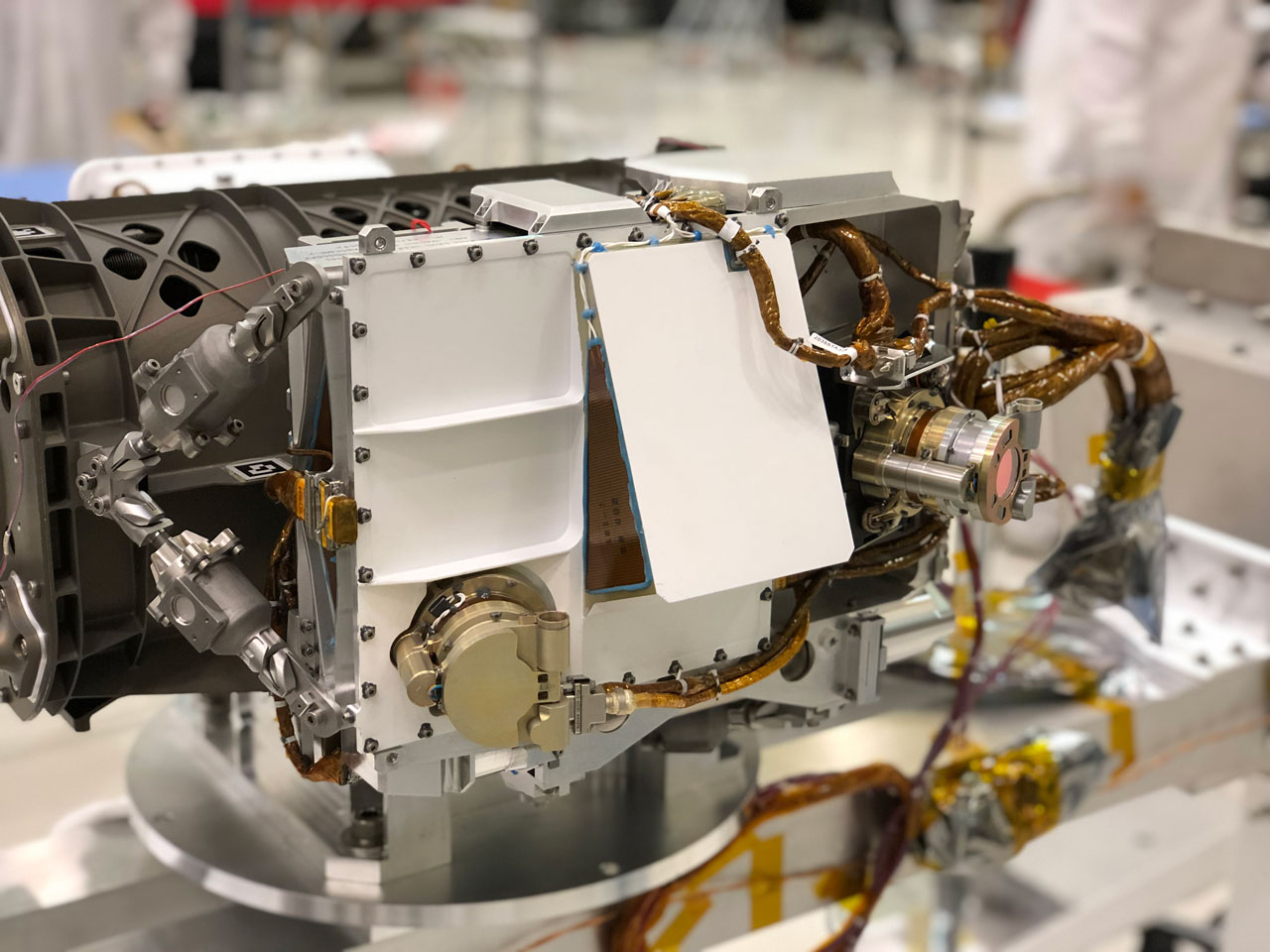 The SHERLOC instrument is located at the end of the robotic arm on NASA's Mars 2020 rover.