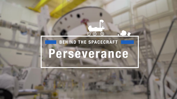 A photo of exploration equipment with the text 'Behind the spacecraft. Perseverance' overlayed.