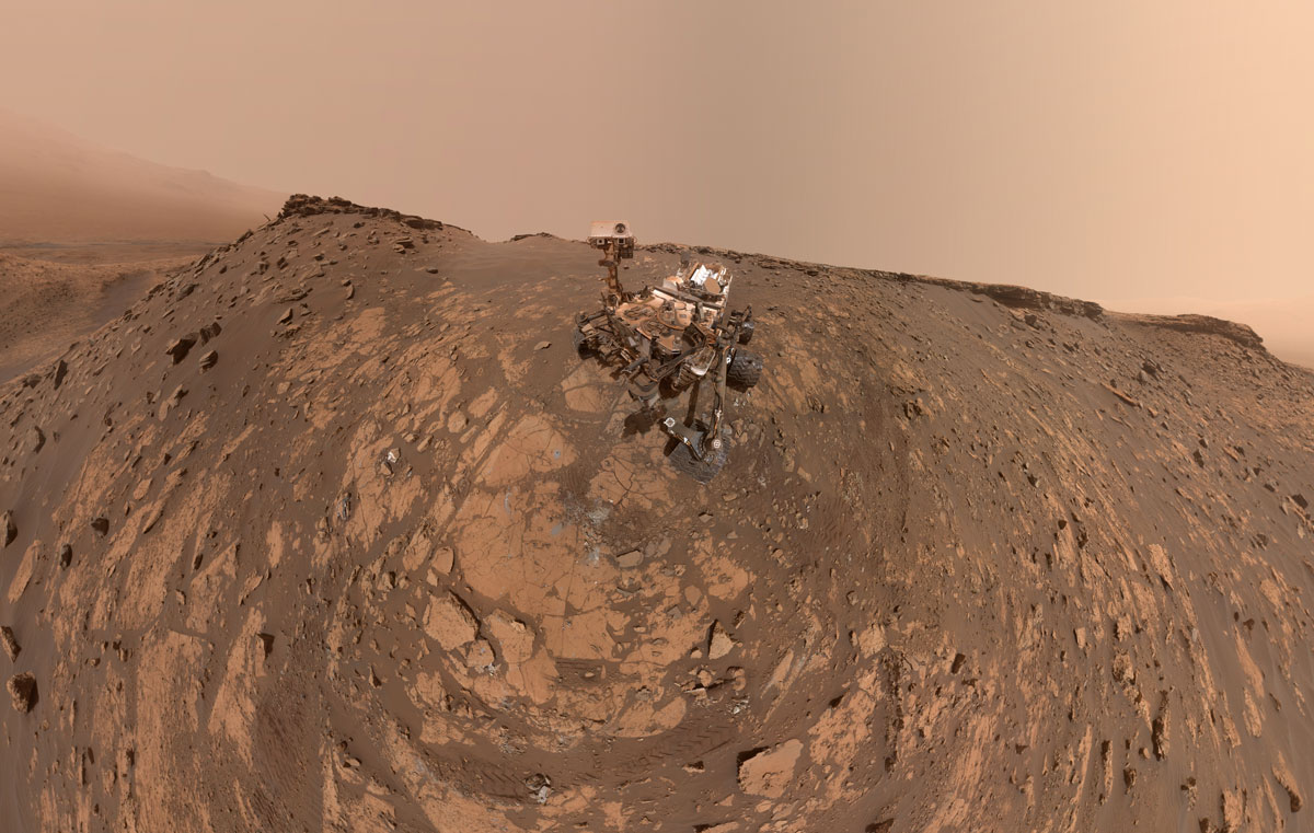 This selfie was taken by NASA's Curiosity Mars rover on Feb. 26, 2020. The crumbling rock layer at the top of the image is the Greenheugh Pediment, which Curiosity climbed soon after taking the image.