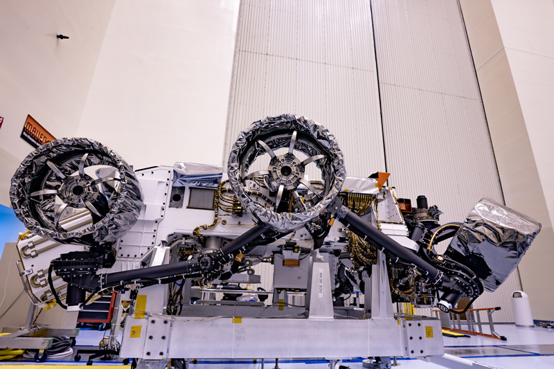A photo of three of the six flight wheels that will travel to Mars can be seen attached to NASA's Perseverance rover