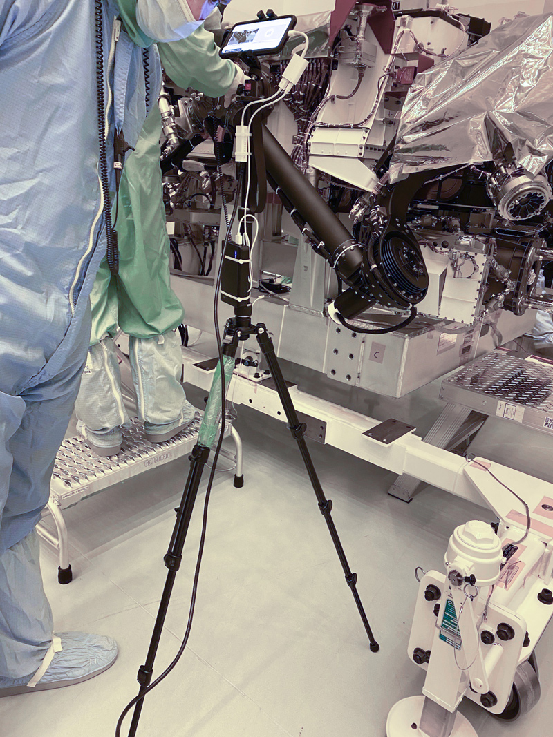 Smartphone Walkdown: A technician points a smartphone camera at NASA's Perseverance rover during an inspection at Kennedy Space Center in Florida.