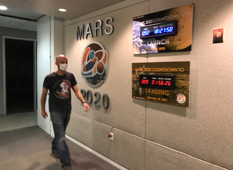 Countdown to Launch: Ian Clark walks past mission countdown clocks in the Perseverance offices at NASA's JPL.