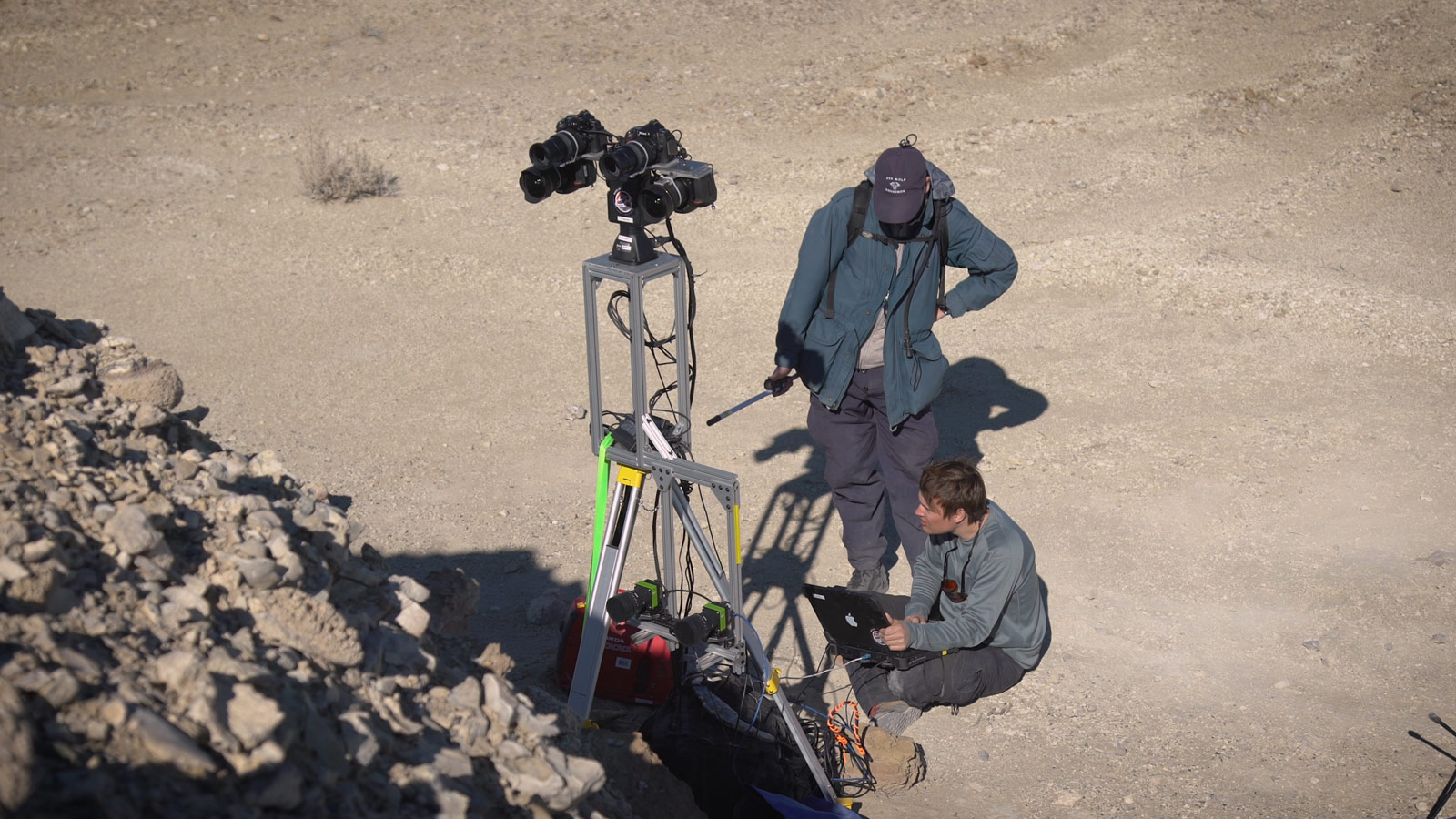 Two members of the field team set up cameras in the Nevada desert.