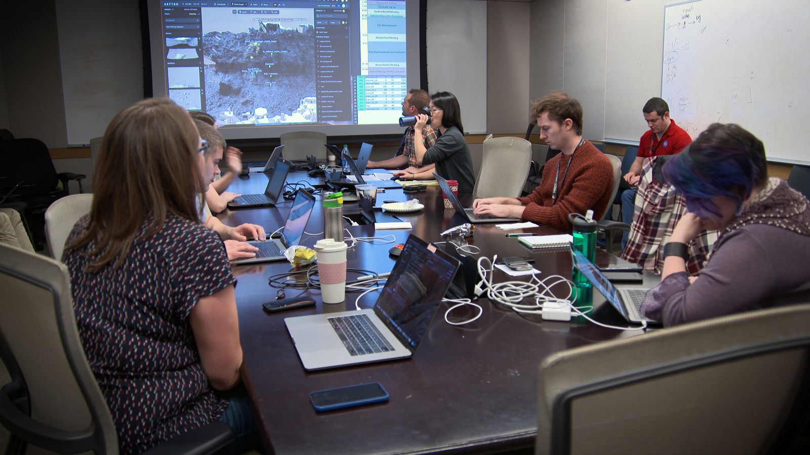 A group of scientists in a conference room