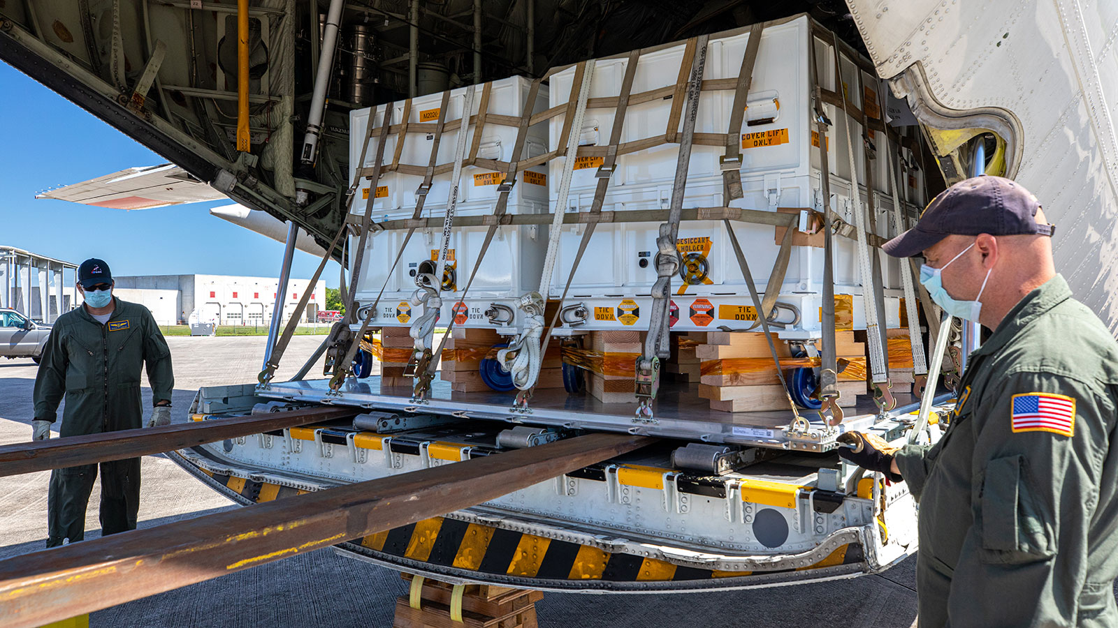Perseverance mission flight hardware and equipment delivered to KSC is unloaded from a NASA Wallops C-130