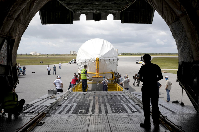 View from inside the Antonov aircraft as the rocket booster for Mars 2020 is offloaded