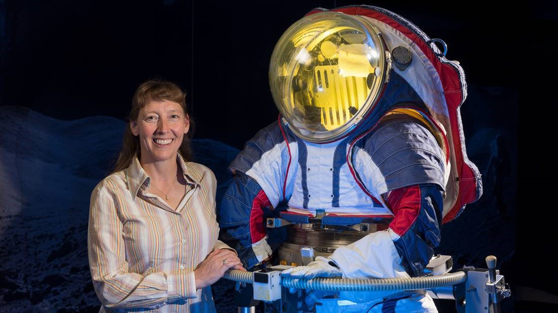 Spacesuit designer Amy Ross stands with the Z-2 prototype spacesuit