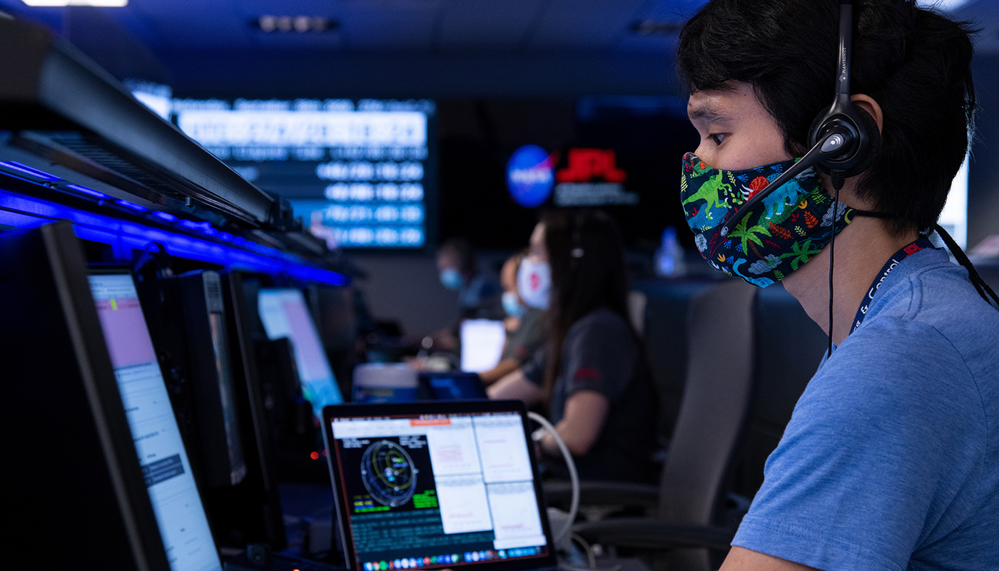 Mars 2020 mission engineer wearing a dinosaur mask during operations.